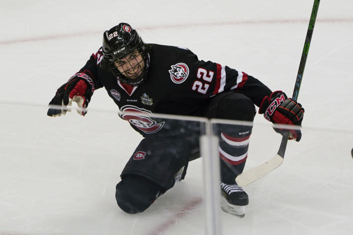 St. Cloud State's Joe Molenaar (22) celebrates after scoring the tying goal against Minnesota State during the third period of an NCAA men's Frozen Four hockey semifinal in Pittsburgh, Thursday, April 8, 2021. St. Cloud State won 5-4 to advance to the championship game Saturday. (AP Photo/Keith Srakocic)