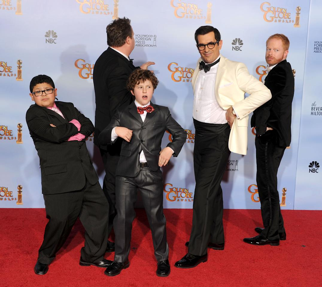 BEVERLY HILLS, CA - JANUARY 15:  (L-R) Actors Rico Rodriguez, Eric Stonestreet, Nolan Gould, Ty Burrell, and Jesse Tyler Ferguson poses in the press room with the Best Television Series - Musical or Comedy award for 'Modern Family' at the 69th Annual Golden Globe Awards held at the Beverly Hilton Hotel on January 15, 2012 in Beverly Hills, California.  (Photo by Kevin Winter/Getty Images)