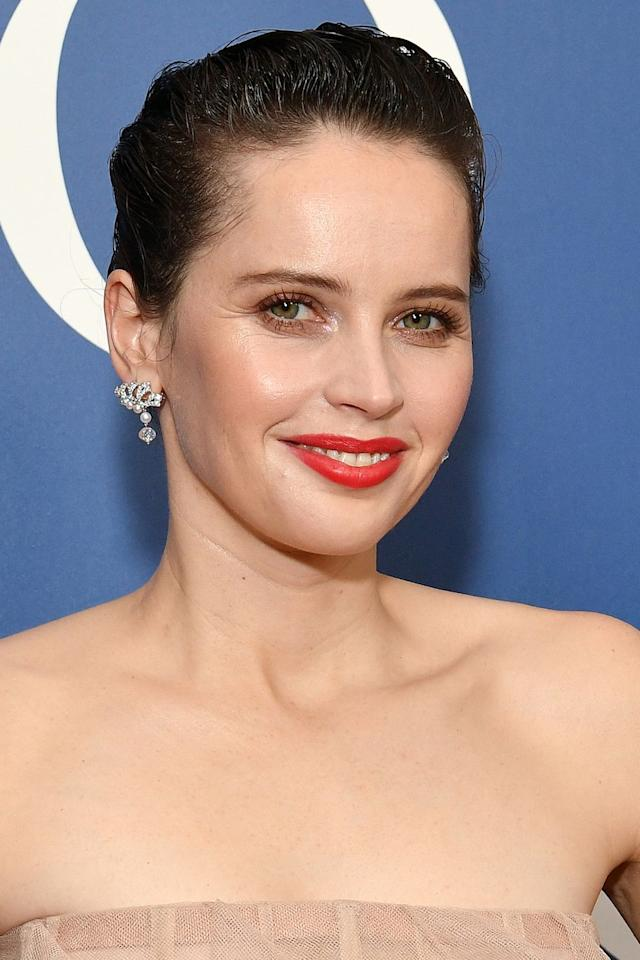 "<p>Felicity Jones brought modern regal glamour to the red carpet over the weekend. With her true red lipstick - try Mac's <a rel=""nofollow"" href=""http://www.selfridges.com/GB/en/cat/mac-lustre-lipstick-3g_329-81004873-LIPSTICK/?"">Retro Matte in Ruby Woo</a> - and elegant up-do, the actress looked every inch a princess, but the wet-look finish added a fresh, contemporary touch. Comb Bumble & bumble's <a rel=""nofollow"" href=""http://www.selfridges.com/GB/en/cat/mac-lustre-lipstick-3g_329-81004873-LIPSTICK/?"">Sumisumo Gel</a> through your hair for the same effect. </p>"