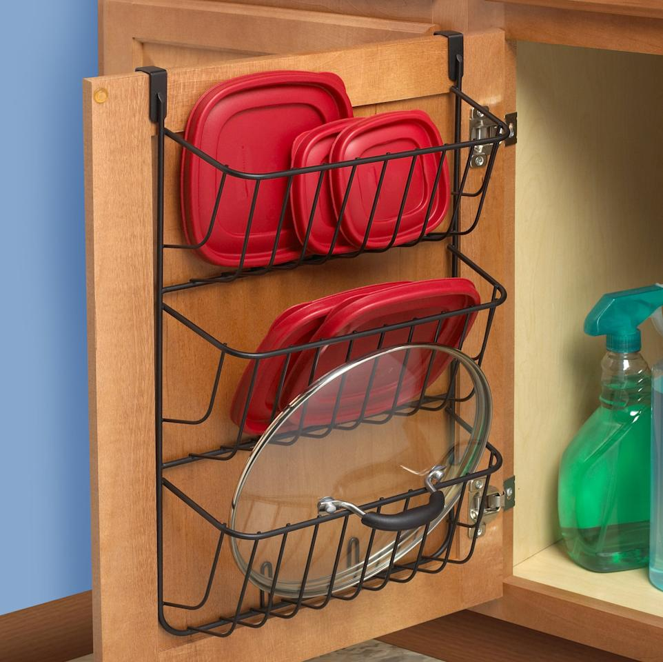 "<p>Keep lids in order with this <a href=""https://www.popsugar.com/buy/3-Tier-Cabinet-Door-Organizer-566703?p_name=3%20Tier%20Cabinet%20Door%20Organizer&retailer=wayfair.com&pid=566703&price=34&evar1=casa%3Aus&evar9=47575922&evar98=https%3A%2F%2Fwww.popsugar.com%2Fhome%2Fphoto-gallery%2F47575922%2Fimage%2F47575949%2F3-Tier-Cabinet-Door-Organizer&list1=gadgets%2Ckitchens%2Chome%20shopping&prop13=mobile&pdata=1"" rel=""nofollow"" data-shoppable-link=""1"" target=""_blank"" class=""ga-track"" data-ga-category=""Related"" data-ga-label=""https://www.wayfair.com/kitchen-tabletop/pdp/spectrum-diversified-3-tier-cabinet-door-organizer-cxz1285.html"" data-ga-action=""In-Line Links"">3 Tier Cabinet Door Organizer</a> ($34).</p>"