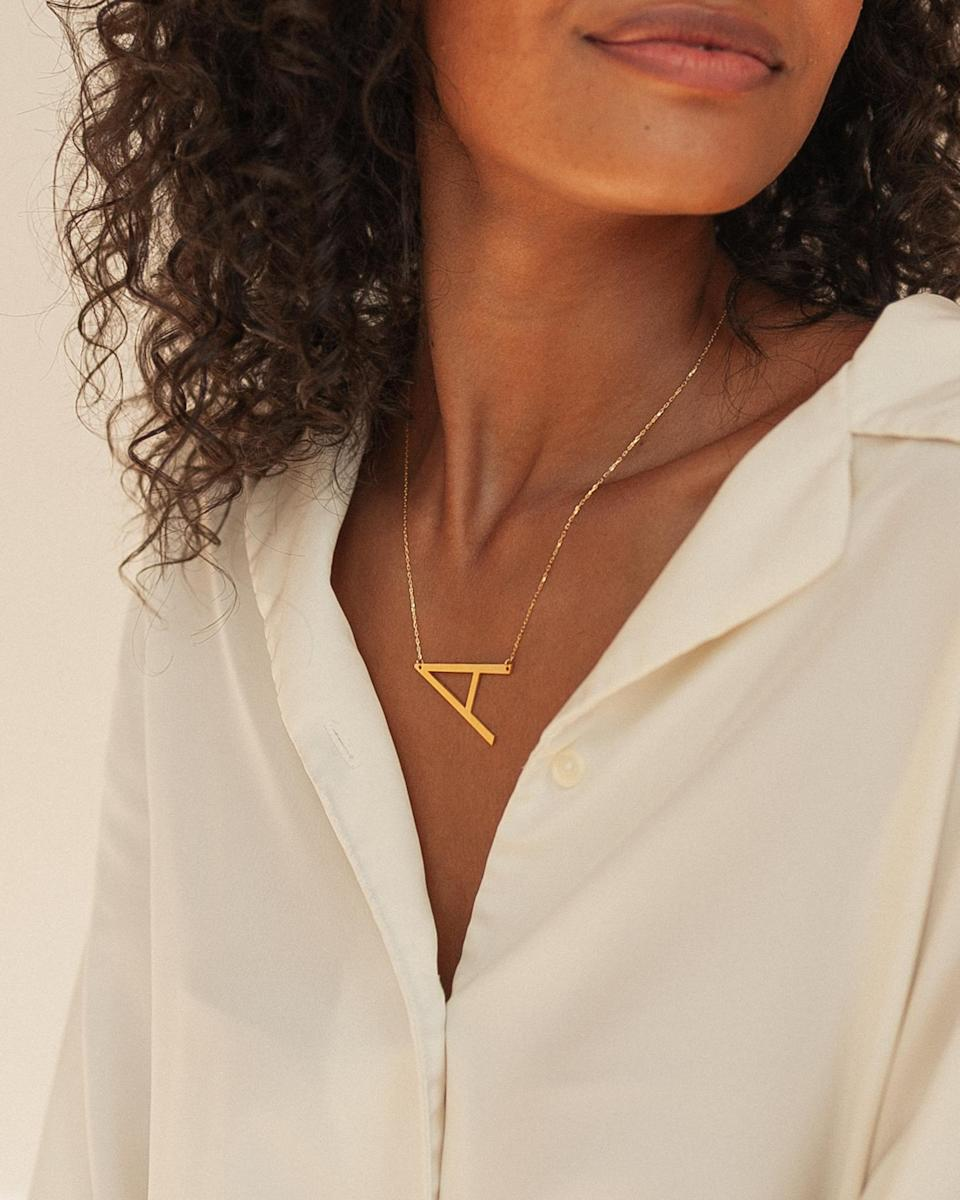 "<br><br><strong>CaitlynMinimalist</strong> Sideways Initial Necklace, $, available at <a href=""https://go.skimresources.com/?id=30283X879131&url=https%3A%2F%2Fwww.etsy.com%2Flisting%2F610973630%2Fsideways-initial-necklace-large-initial"" rel=""nofollow noopener"" target=""_blank"" data-ylk=""slk:Etsy"" class=""link rapid-noclick-resp"">Etsy</a>"