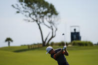 Garrick Higgo, of South Africa, hits from the fairway on the third hole during a practice round at the PGA Championship golf tournament on the Ocean Course Tuesday, May 18, 2021, in Kiawah Island, S.C. (AP Photo/David J. Phillip)