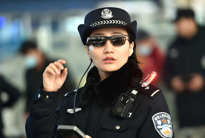 A Chinese police officer in Zhengzhou in China's central Henan province wearing high-tech sunglasses that can spot suspects in a crowded train station, the newest use of facial recognition that has raised concerns among human rights groups (AFP Photo/-)
