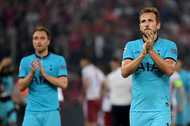 Spurs players disappointed after giving up 2-0 lead. (Photo by ARIS MESSINIS / AFP)