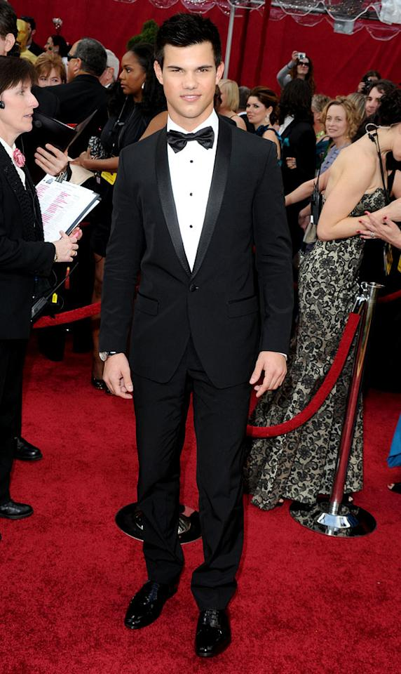 "Taylor Lautner   Grade: A-    The ""Twilight"" heartthrob popped his signature lopsided pose in a Dolce & Gabbana ensemble."