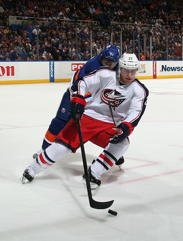 UNIONDALE, NY - OCTOBER 05: Ryan Murray #27 of the Columbus Blue Jackets carries the puck against the New York Islanders at the Nassau Veterans Memorial Coliseum on October 5, 2013 in Uniondale, New York. (Photo by Bruce Bennett/Getty Images)