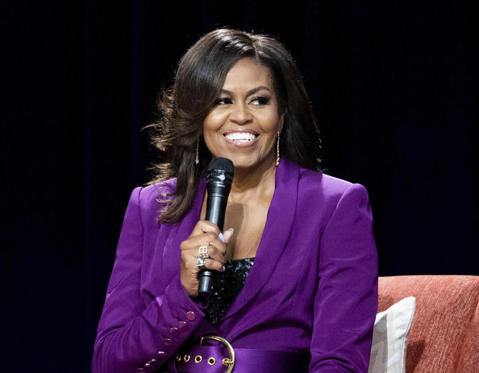 """FILE - This May 11, 2019 file photo shows former first lady Michelle Obama during """"Becoming: An Intimate Conversation with Michelle Obama,"""" in Atlanta. Netflix says a documentary portrait of Michelle Obama titled """"Becoming"""" will premiere on its streaming service next week. It chronicles her 34-city book tour in 2018-2019 for her memoir """"Becoming."""" (Photo by Paul R. Giunta/Invision/AP, File)"""