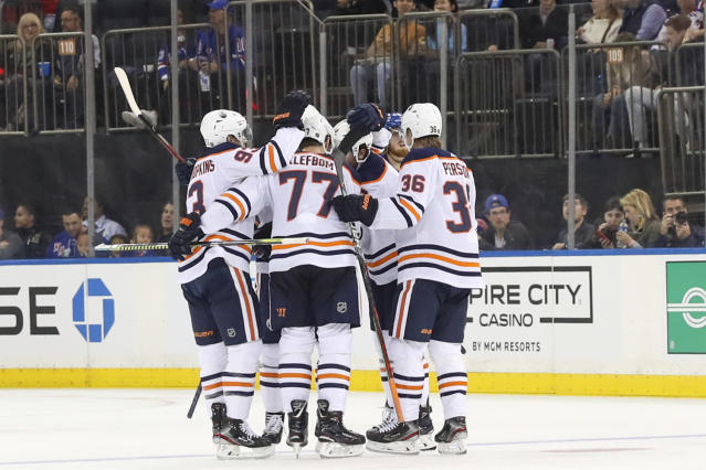 The Edmonton Oilers celebrate a goal by defenseman Oscar Klefbom (77) during the second period of an NHL hockey game against the New York Rangers, Saturday, Oct. 12, 2019, at Madison Square Garden in New York. (AP Photo/Mary Altaffer)