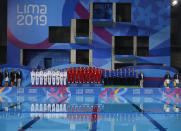 Gold medalists of Canada, center, silver of Mexico, left, and bronze of the United States, listen to Canada's national anthem after the finals of team competition free artistic swimming at the Pan American Games in Lima, Peru, Wednesday, July 31, 2019. (AP Photo/Moises Castillo)