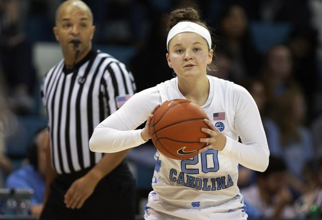 FILE - In this Thursday, Jan. 17, 2019 file photo, North Carolina's Leah Church (20) looks to pass during an NCAA college basketball game in Chapel Hill, N.C. North Carolina guard Leah Church is getting national attention for a viral video showing her making three straight 3-pointers while shooting over her head and with her back to the basket. The clip now has more than 1 million views and was featured on NBCs Today show. (AP Photo/Ben McKeown, File)