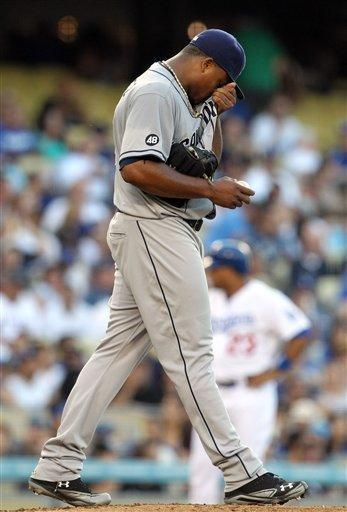 San Diego Padres pitcher Edinson Volquez walks back to the mound after walking in a bases-loaded run by the Los Angeles Dodgers in the third inning of a baseball game in Los Angeles, Saturday, July 14, 2012. (AP Photo/Reed Saxon)