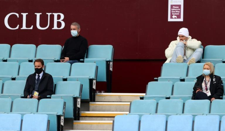 Watching brief - Aston Villa's injured midfielder Jack Grealish (top R) follows the game from the Villa Park stands along with England manager Gareth Southgate (L)