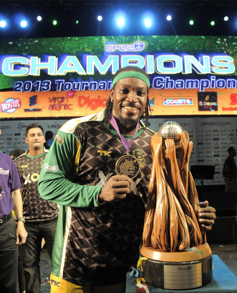 PORT OF SPAIN, TRINIDAD AND TOBAGO - AUGUST 24: The victorious Jamaica Tallawahs Captain Chris Gayle poses with the Trophy after winning the Final of the Cricket Caribbean Premier League between Guyana Amazon Warriors v Jamaica Tallawahs at Queen's Park Oval on August 24, 2013 in Port of Spain, Trinidad and Tobago. (Photo by Randy Brooks/Getty Images Latin America for CPL)