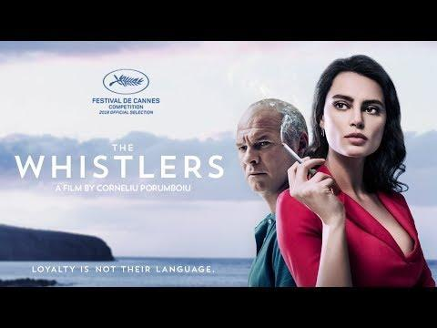"""<p>Romanian director Corneliu Porumboiu once again melds his interests in language and genre filmmaking with <em>The Whistlers</em>, a neo-noir about a police officer named Cristi (Vlad Ivanov) who travels to the Canary Island of La Gomera to learn an ancient whistling language that doesn't sound anything like a human form of communication. This subterfuge is demanded by Cristi's gangster bosses, with whom he's both in league with and tasked with nabbing by his law enforcement chief Magda (Rodica Lazar). Cristi's playing-both-sides predicament is complicated by his relationship with Gilda (Catrinel Marlon), an alluring beauty whose femme fatale status is underlined by her famous noir name, and Porumboiu fractures his narrative so that chronology, like the various dialects employed by his characters, comes across as intricately coded. Repeatedly shouting out to both crime movies and Westerns – even its title and central conceit feel like references to Lauren Bacall's iconic <em>To Have and Have Not</em> line of dialogue – the director orchestrates his action with slippery subtlety and droll humor, and he continually surprises on his way to an expressively non-verbal finale of light and music.</p><p><a class=""""link rapid-noclick-resp"""" href=""""https://www.amazon.com/Whistlers-Vlad-Ivanov/dp/B086K5CTHP/?tag=syn-yahoo-20&ascsubtag=%5Bartid%7C10054.g.29500577%5Bsrc%7Cyahoo-us"""" rel=""""nofollow noopener"""" target=""""_blank"""" data-ylk=""""slk:Watch Now"""">Watch Now</a></p><p><a href=""""https://www.youtube.com/watch?v=d7I6i943qUA"""" rel=""""nofollow noopener"""" target=""""_blank"""" data-ylk=""""slk:See the original post on Youtube"""" class=""""link rapid-noclick-resp"""">See the original post on Youtube</a></p>"""