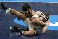 Iowa's Spencer Lee, right, takes on Arizona State's Brandon Courtney during their 125-pound match in the finals of the NCAA wrestling championships Saturday, March 20, 2021, in St. Louis. (AP Photo/Jeff Roberson)