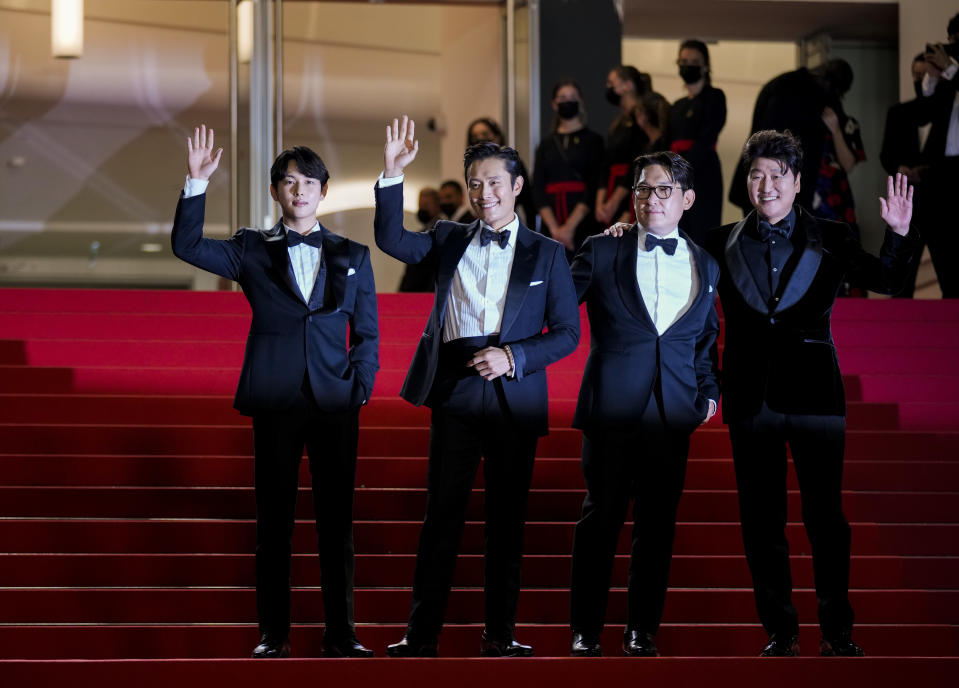 FILE - In this July 16, 2021 file photo Yim Si-wan, from left, Lee Byung-hun, director Han Jae-rim, and Song Kang-ho pose for photographers upon arrival at the premiere of the film 'Emergency Declaration' at the 74th international film festival, Cannes, southern France. (AP Photo/Vadim Ghirda, File)