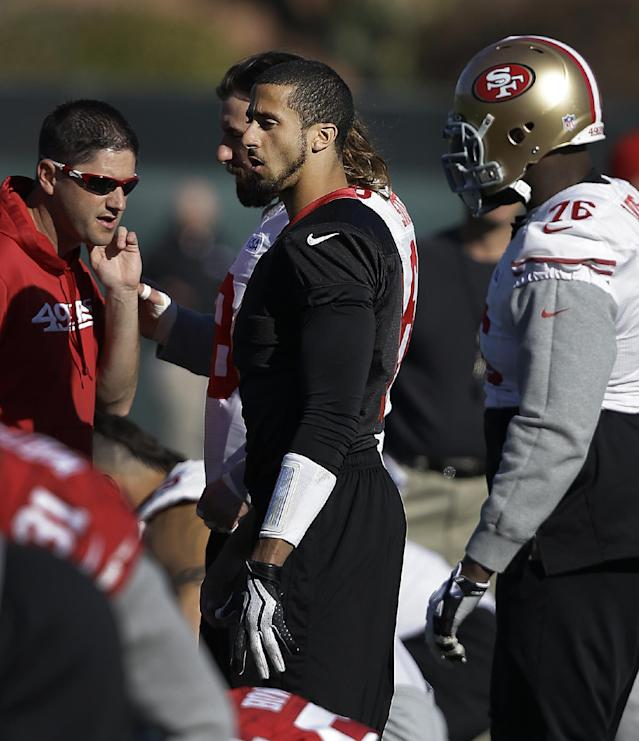 San Francisco 49ers quarterback Colin Kaepernick, center, prepares for an NFL football practice in Santa Clara, Calif., Friday, Jan. 17, 2014. The 49ers are scheduled to play the Seattle Seahawks for the NFC championship on Sunday. (AP Photo/Ben Margot)