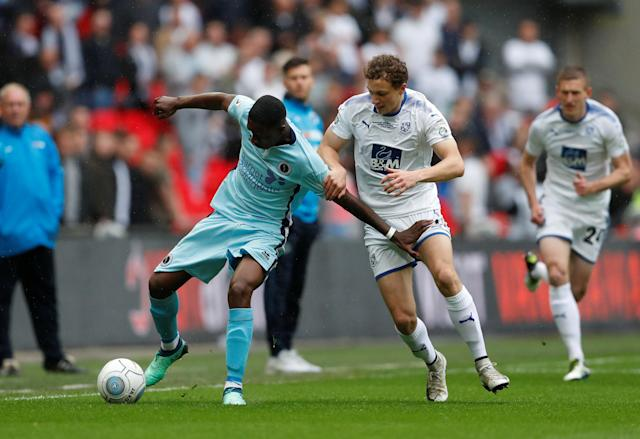 Soccer Football - National League Promotion Final - Tranmere Rovers v Boreham Wood - Wembley Stadium, London, Britain - May 12, 2018 Tranmere Rovers' Eddie Clarke in action with Boreham Woods' Michael Folivi Action Images/Matthew Childs
