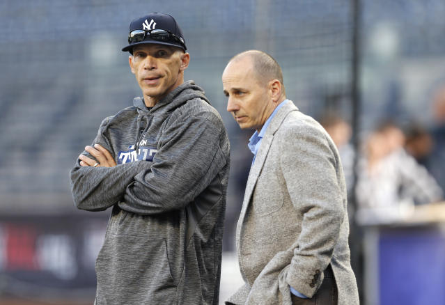Joe Girardi and Brian Cashman weren't on the same page. (AP Photo/Kathy Willens, File)