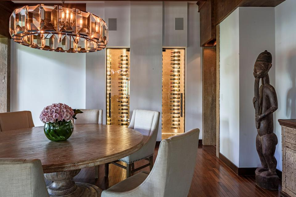 The dining room features a wine cellar.