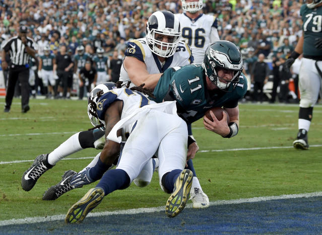 Philadelphia Eagles quarterback Carson Wentz suffered what is feared to be an ACL injury against the Rams. (AP)