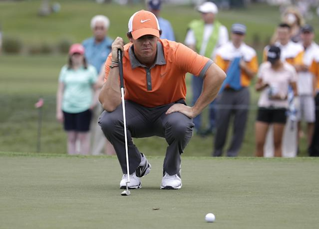 Rory McIlroy of Northern Ireland lines up a putt on the fourth hole during the first round of the Honda Classic golf tournament, Thursday, Feb. 27, 2014, in Palm Beach Gardens, Fla. (AP Photo/Lynne Sladky)