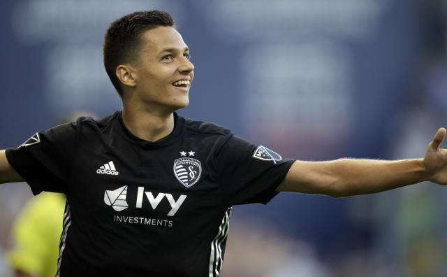 Sporting Kansas City forward Daniel Salloi celebrates his goal during the first half of an MLS soccer match against Minnesota United in Kansas City, Kan., Sunday, June 3, 2018. (AP Photo/Orlin Wagner)