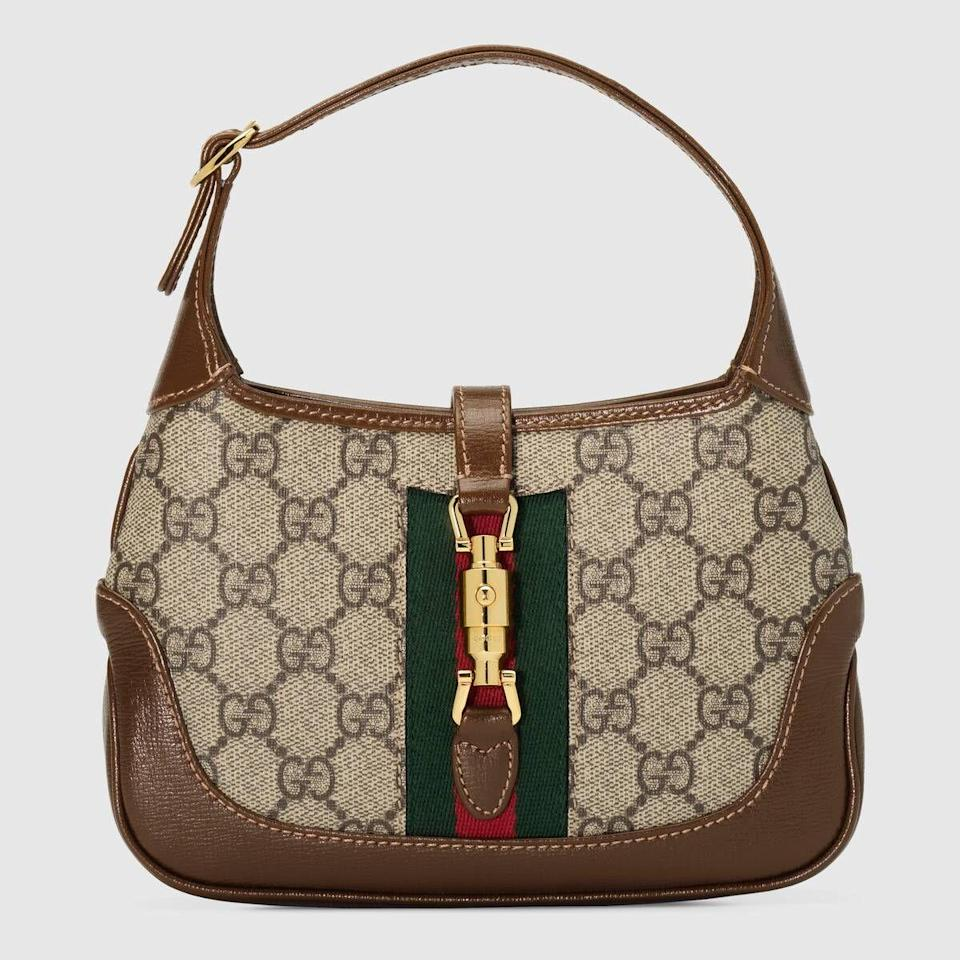 """<p><strong>Gucci</strong></p><p>gucci.com</p><p><strong>$1700.00</strong></p><p><a href=""""https://go.redirectingat.com?id=74968X1596630&url=https%3A%2F%2Fwww.gucci.com%2Fus%2Fen%2Fpr%2Fwomen%2Fhandbags%2Fshoulder-bags-for-women%2Fbucket-bags-for-women%2Fjackie-1961-mini-hobo-bag-p-637092HUHHG8565&sref=https%3A%2F%2Fwww.harpersbazaar.com%2Ffashion%2Ftrends%2Fg35048473%2Fbags-for-2021%2F"""" rel=""""nofollow noopener"""" target=""""_blank"""" data-ylk=""""slk:Shop Now"""" class=""""link rapid-noclick-resp"""">Shop Now</a></p><p>The iconic Gucci bag has received an upgrade to fit perfectly into our 2021 plans. Loved by the fashion icon and First Lady Jackie O, this new bag is just as chic.</p>"""