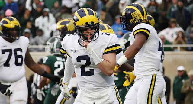 Shea Patterson celebrates during Michigan's win over rival Michigan State. (AP)