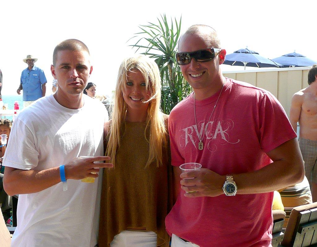 Tara Reid is surrounded by some guy candy. omg! staff/Polaroid Malibu Beach House - July 23, 2007