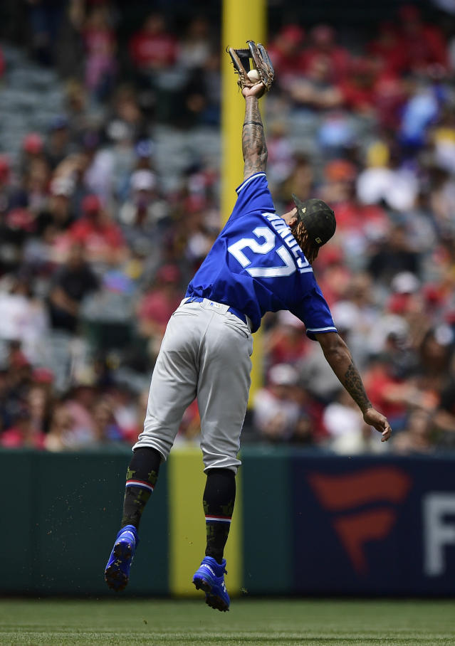 Kansas City Royals short stop Adalberto Mondesi makes a catch on a ball hit by Los Angeles Angels' Tommy La Stella during the second inning of a baseball game Sunday, May 19, 2019, in Anaheim, Calif. (AP Photo/Mark J. Terrill)