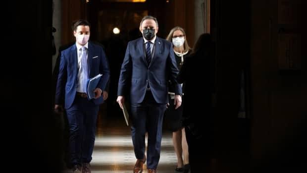 Quebec's Minister Responsible for the French Language, Simon Jolin-Barrette, walks with Premier François Legault after presenting Bill 96.                                (Sylvain Roy Roussel/CBC - image credit)