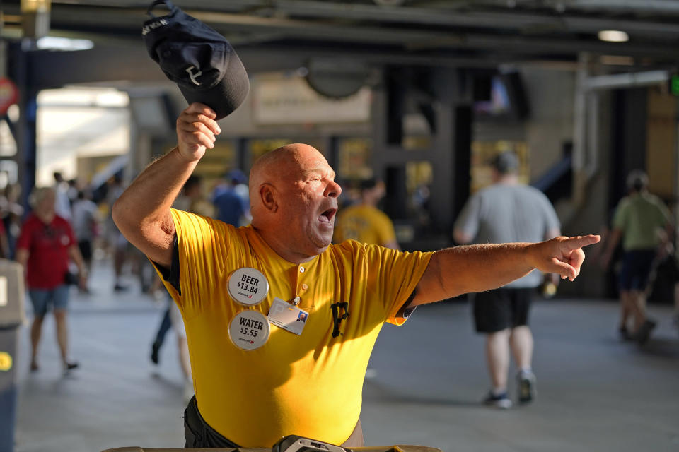 Tom Congdon, a vendor at Pittsburgh sports venues for 38 years, mans his beer and water cart in the concourse at PNC Park, before a baseball game between the Pittsburgh Pirates and the Atlanta Braves in Pittsburgh, Monday, July 5, 2021. It would be premature to say that the scene at major league ballparks has completely returned to normal, but there's no question this season has been a step in that direction — perhaps most crucially for the people who work there.(AP Photo/Gene J. Puskar)