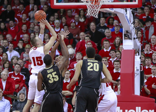 Wisconsin's Sam Dekker (15) shoots against Purdue's Raphael Davis (35) and Vince Edward, behind, during the first half of an NCAA college basketball game Wednesday, Jan. 7, 2015, in Madison, Wis. (AP Photo/Andy Manis)