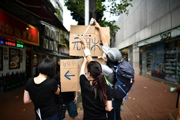 Protesters began gathering in Yuen Long despite a police ban (AFP Photo/Anthony WALLACE)