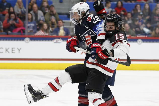 United States' Kacey Bellamy (22) defends against Canada's Mélodie Daoust (15) during the second period of a rivalry series women's hockey game in Hartford, Conn., Saturday, Dec. 14, 2019. (AP Photo/Michael Dwyer)