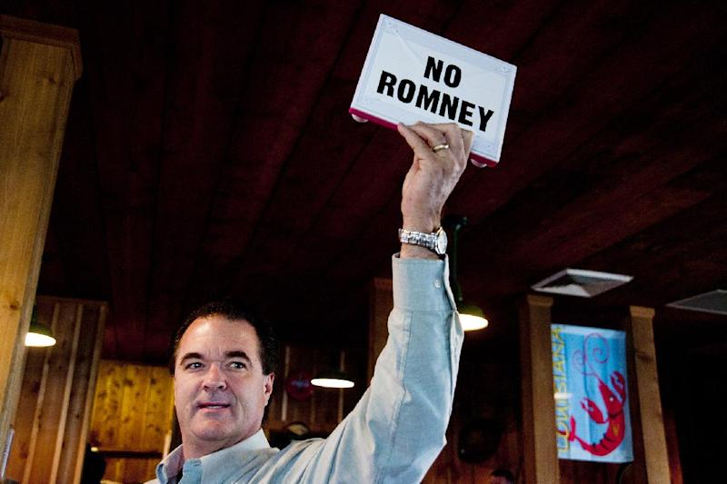 """Jeff Giles, a Republican delegate of Houma, holds up an Etch A Sketch with a """"NO ROMNEY"""" banner, during Republican presidential candidate Newt Gingrich's campaign stop at Big Al's Seafood Restaurant on Thursday, March 22, 2012 in Houma, La. (AP Photo/The Houma Daily Courier, Michael Conti) MAGS OUT; NO SALES; MANDATORY CREDIT"""