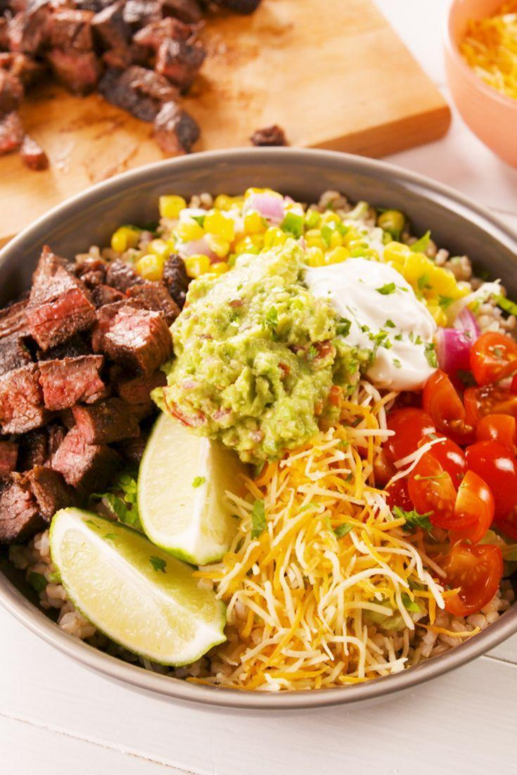 """<p>Grain bowls are our favorite way to eat healthy without sacrificing taste.</p><p>Get the recipe from <a href=""""https://www.delish.com/cooking/recipe-ideas/a21204075/steak-burrito-bowls-recipe/"""" rel=""""nofollow noopener"""" target=""""_blank"""" data-ylk=""""slk:Delish"""" class=""""link rapid-noclick-resp"""">Delish</a>.</p>"""