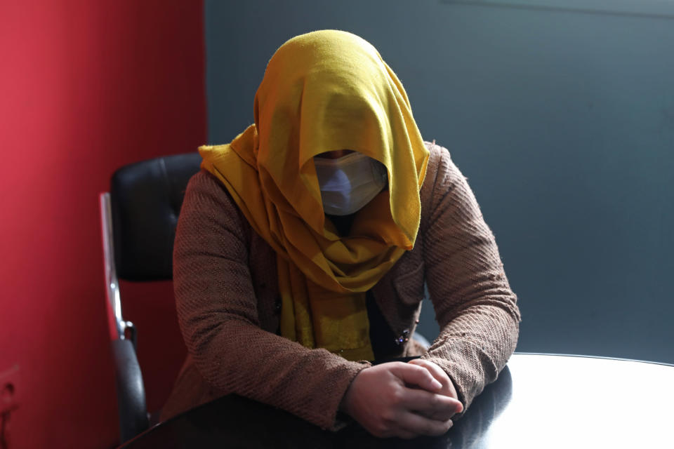 A female TV presenter from southern Afghanistan hides her identity for security concerns as she gives an interview to The Associated Press in Kabul, Afghanistan, Wednesday, Feb. 3, 2021. In just the last six months, 15 journalists have been killed in a series of targeted killings spreading fear among Afghanistan's journalist community. Along with journalists, Judges, lawyers and activists have also been targeted in a wave of assassinations since Washington signed a peace deal with the Taliban a year ago. (AP Photo/Rahmat Gul)