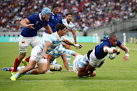 """A photographer's dream, Virimi Vakatawa of France appears to fly through the air for his side's first try in the hard fought 23-21 victory over Argentina. Cameron Spencer (Getty Images) captures the shot: """"Fortunately he scored a try right in front of me and I was using the 70-200mm lens and f3.2 to separate the action from the background with a shallow depth of field and a shutter speed of 2000th to freeze the action."""""""