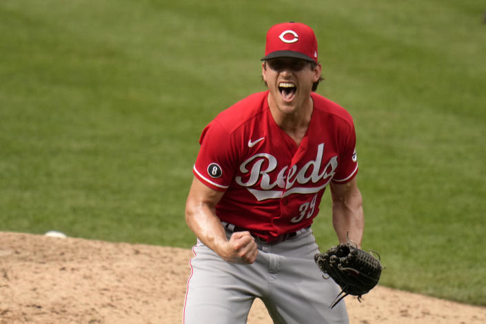 Cincinnati Reds pitcher Lucas Sims celebrates after striking out St. Louis Cardinals' Jose Rondon for the final out of a baseball game Sunday, June 6, 2021, in St. Louis. The Reds won 8-7. (AP Photo/Jeff Roberson)