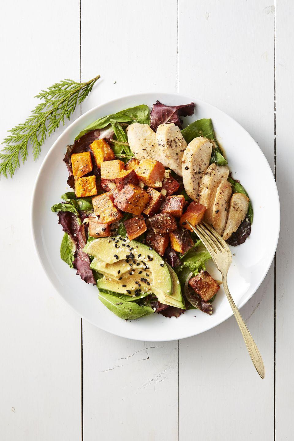 "<p>A hearty trifecta of <a href=""https://www.goodhousekeeping.com/food-recipes/g657/sweet-potato-recipes/"" rel=""nofollow noopener"" target=""_blank"" data-ylk=""slk:sweet potatoes"" class=""link rapid-noclick-resp"">sweet potatoes</a>, chicken, and avocado mean this salad recipe will actually fill you up. It's the umami-flavored miso vinaigrette that will inspire you to make it again and again. </p><p><em><a href=""https://www.goodhousekeeping.com/food-recipes/easy/a42180/roasted-sweet-potato-and-chicken-salad-recipe/"" rel=""nofollow noopener"" target=""_blank"" data-ylk=""slk:Get the recipe for Roasted Sweet Potato and Chicken Salad »"" class=""link rapid-noclick-resp"">Get the recipe for Roasted Sweet Potato and Chicken Salad »</a></em></p>"