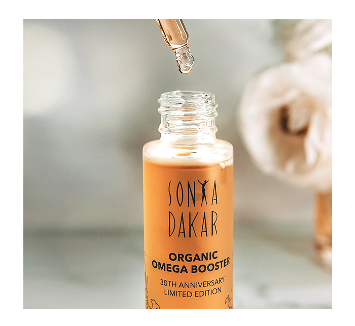 """<p><strong>Sonya Dakar</strong></p><p>sonyadakar.com</p><p><strong>$127.00</strong></p><p><a href=""""https://sonyadakar.com/products/organic-omega-booster-30th-anniversary-limited-release"""" rel=""""nofollow noopener"""" target=""""_blank"""" data-ylk=""""slk:Shop Now"""" class=""""link rapid-noclick-resp"""">Shop Now</a></p><p>""""For the entire time of the pandemic, I've been using Sonya Dakar's Organic Omega Booster, which she created as a limited edition to celebrate her company's 30th anniversary. It smells just incredible and gives my skin a dewy glow. Imagine the scent of Moroccan rose, orange flower, Egyptian geranium, and Tunisian jasmine. It was an exotic vacation in a bottle and a balm for my restless travel-eager soul.""""— <em>Karen Lubeck, Associate Research Editor</em></p>"""