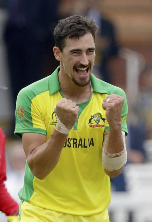Australia's Mitchell Starc celebrates taking the wicket of England's captain Eoin Morgan during the Cricket World Cup match between England and Australia at Lord's cricket ground in London, Tuesday, June 25, 2019. (AP Photo/Matt Dunham)
