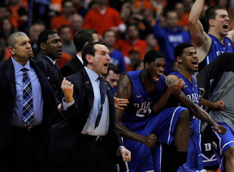 Duke coach Mike Krzyzewksi, center, reacts with players and coaches on the bench late in the second half of an NCAA college basketball game in Syracuse, N.Y., Saturday, Feb. 1, 2014. Syracuse won 91-89. (AP Photo/Nick Lisi)