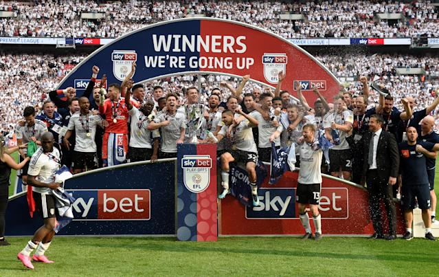 "Soccer Football - Championship Play-Off Final - Fulham vs Aston Villa - Wembley Stadium, London, Britain - May 26, 2018 Fulham celebrate promotion to the Premier League with the trophy Action Images via Reuters/Tony O'Brien EDITORIAL USE ONLY. No use with unauthorized audio, video, data, fixture lists, club/league logos or ""live"" services. Online in-match use limited to 75 images, no video emulation. No use in betting, games or single club/league/player publications. Please contact your account representative for further details."