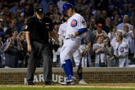 Chicago Cubs' Anthony Rizzo, center, crosses home plate after hitting a home run against the St. Louis Cardinals during the third inning of a baseball game Thursday, Sept. 19, 2019, in Chicago. (AP Photo/Matt Marton)