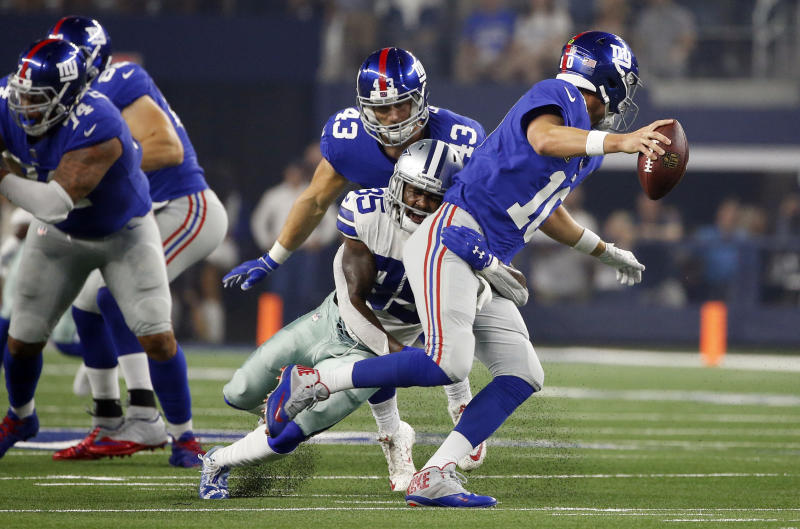 New York Giants quarterback Eli Manning (10) is sacked for a loss by Dallas Cowboys defensive back Kavon Frazier (35) during the first half of an NFL football game in Arlington, Texas, Sunday, Sept. 16, 2018. (AP Photo/Ron Jenkins)