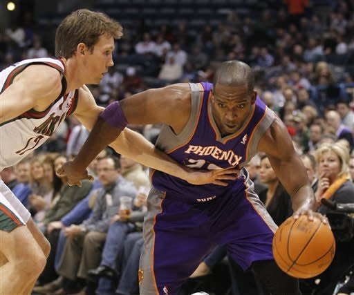 Phoenix Suns' Michael Redd (22) drives against Milwaukee Bucks' Mike Dunleavy, left, during the first half of an NBA basketball game on Tuesday, Feb. 7, 2012, in Milwaukee. (AP Photo/Jeffrey Phelps)