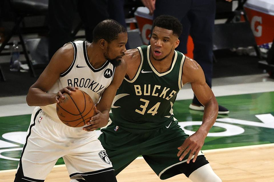 MILWAUKEE, WISCONSIN - MAY 02: Kevin Durant #7 of the Brooklyn Nets is defended by Giannis Antetokounmpo #34 of the Milwaukee Bucks during the second half of a game at Fiserv Forum on May 02, 2021 in Milwaukee, Wisconsin. NOTE TO USER: User expressly acknowledges and agrees that, by downloading and or using this photograph, User is consenting to the terms and conditions of the Getty Images License Agreement. (Photo by Stacy Revere/Getty Images)